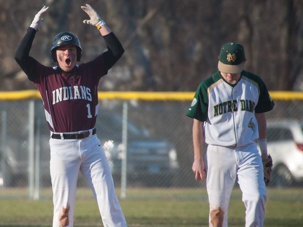Sophomore Matt DeRosa celebrates at second base after hitting a double that gave the North Haven baseball team a 4-3 win versus Notre Dame-West Haven on April 5. The Indians went on to defeat Fairfield Warde 13-3 to improve to 2-1 on the young season. Photo by Kelley Fryer/The Courier