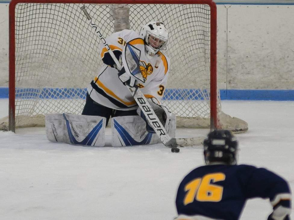 Goalie Matt Twarowski stood tall in net throughout the season to help the East Haven-Old Lyme-Old Saybrook-East Hampton boys' ice hockey team qualify for states in its first year as a co-op squad. Photo by Kelley Fryer/The Courier