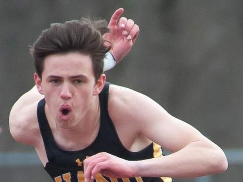 Greyson McGeary and the Hand boys' outdoor track team bested rival Guilford and also defeated Career on April 10 to start their season with a record of 2-0. Photo by Kelley Fryer/The Source