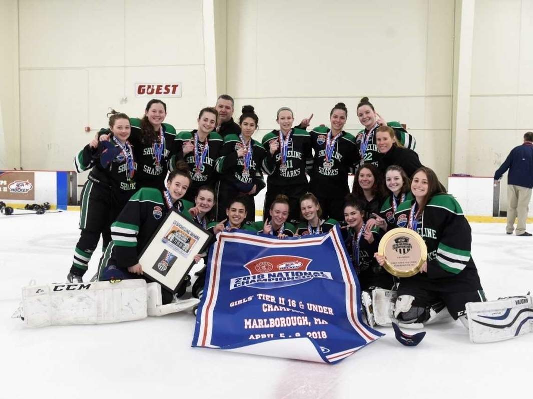 The Shoreline Sharks U-16 Black team took home the USA Girls' Ice Hockey 2018 Tier II national title with a 1-0 win over the Vermont Shamrocks in Marlborough, Massachusetts on April 9. Pictured from the squad are (front) Carina Mancini (Middlefield), Gillian Maher (Pearl River, New York), Juliana Constantinople (East Haven), Ciara Halloran (Madison), Kate Hagness (Guilford), Meagan Spring (North Haven), coach Karlyn Donovan (Hamden), Lilly D'Ancicco (Madison), and Tatum Courtmanche (Madison); along with (back) Lauren Mullally (New Haven), Cally Dixon (Woodbridge), Jessica Pitaniello (Fairfield), coach Ed Rodham (Madison), Melissa Montesi (North Haven), Emily Bouvier (Shelton), Taylor Nowak (West Haven), Meaghan Hogan (Cheshire), and coach Rachel Farrel (Cheshire). Photo courtesy of the Shoreline Sharks