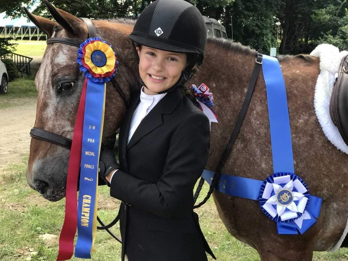 Baldwin Middle School 6th-grader Kennedy Teasdale has experienced a great deal of success in the sport of equestrian, including a spot at the Interscholastic Equestrian Association Nationals that are taking place in Syracuse, New York this week.  Photo courtesy of Cara Mulqueen-Teasdale