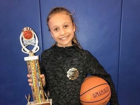 Westbrook resident Anna Landino went 15-of-25 from the foul line to take first place in the 9 Year-Old Division at the Knights of Columbus State Free Throw Contest final. Photo courtesy of Kelly Landino