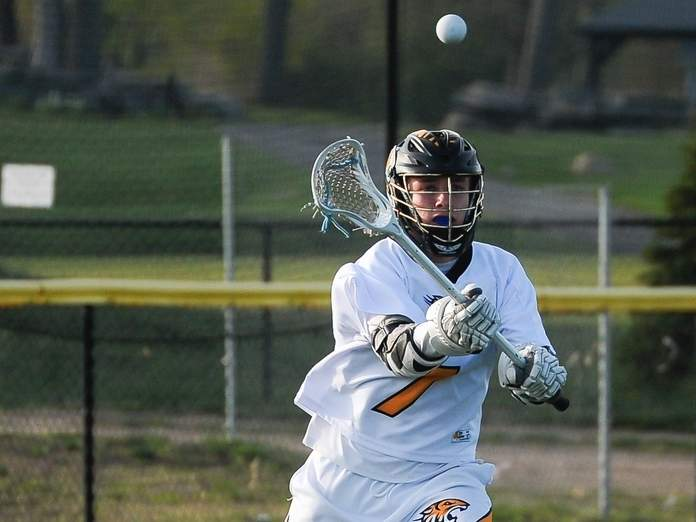 Nate Palumbo capped off his four-goal game for the Hand boys' lacrosse team by netting the game-winner in overtime when the Tigers posted a 9-8 victory over Cheshire on April 16. Photo by Kelley Fryer/The Source