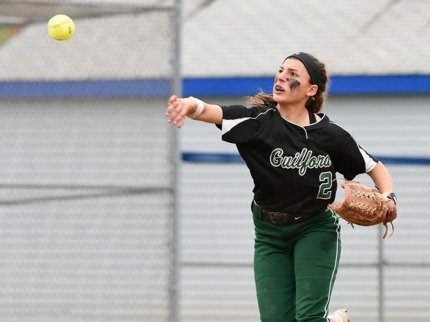 Ava Gladwin and the Guilford softball team defeated Lyman Hall and Career last week to improve to 5-1 on the season. Teammates Amanda King and Ema Signore combined to throw a no-hitter when the Indians earned a 13-0 win over Career in the SCC Hammonasset Division opener. Photo by Wesley Bunnell/The Courier