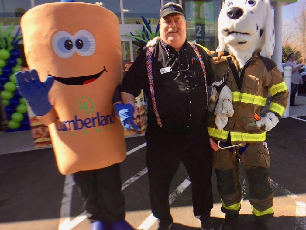 Jenny Swol (swaddled in an iced coffee outfit, Essex Fire Chief Paul Fazzino, Jr., and firefighter Dylan Defrino (in costume as Sparky) greeted passersby at the grand re-opening of the Cumberland Farms store in Centerbrook. Photo by Rita Christopher/The Courier