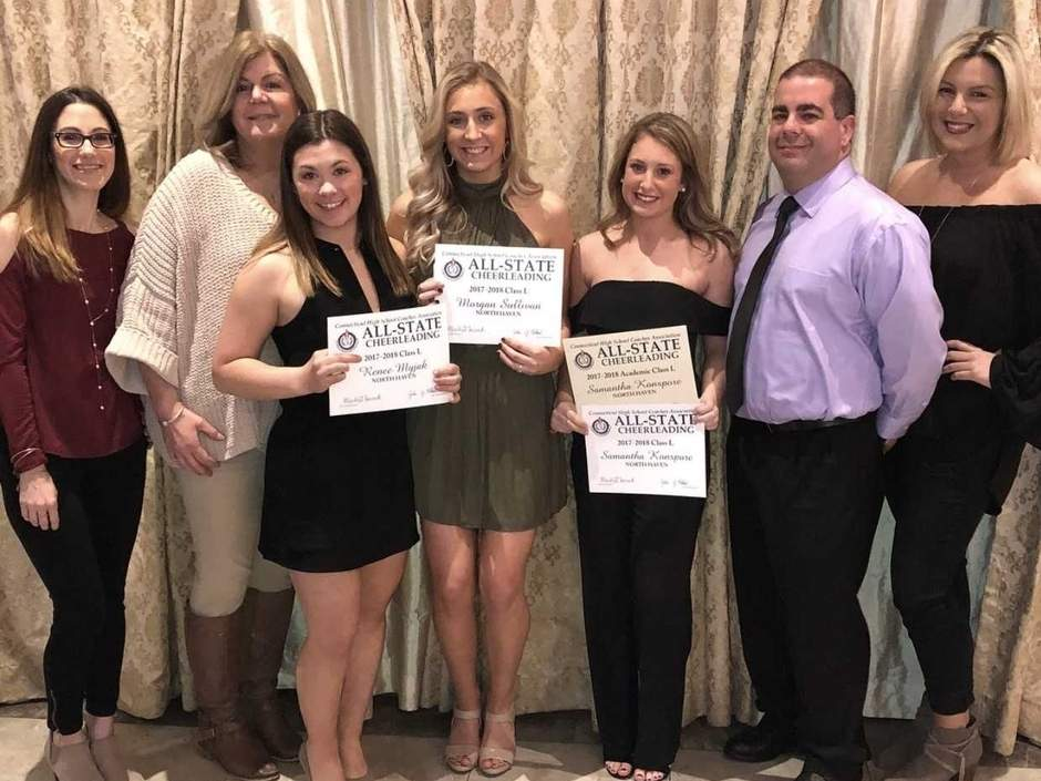 Samantha Konspore, Morgan Sullivan, and Renee Myjak earned spots on the All-State Class L cheerleading team for North Haven this winter. Pictured are assistant coach Melissa Thomas, Head Coach Kathleen Crisafi, Myjak, Sullivan, Konspore, assistant coach Jason Burroughs, and assistant coach Kayla Crisafi. Photo courtesy of Arlene Myjak