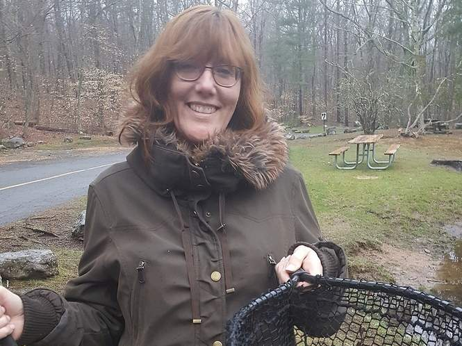 The big one got away, but Debra Benton of Killingworth did land this hefty, three-pound rainbow trout at a local fishing hole. Photo courtesy of Captain Morgan