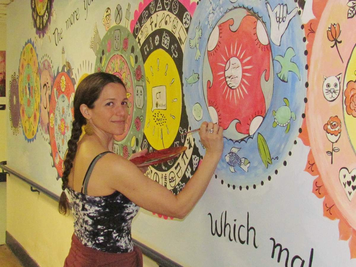 At the invitation of Adams Middle School PTO, community artist and art educator Daniela Balzano is incorporating 600 individual symbols drawn by each student into a mandala mural. Her goal is to create a single work of community art which celebrates every students' unique mark in the world. Photo by Pam Johnson/Guilford Courier