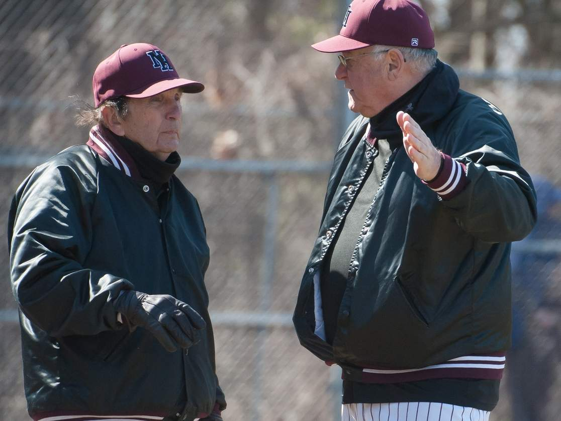 In his 60th season as head coach of the North Haven baseball team, Head Coach Bob DeMayo is closing in on his 900th victory. DeMayo drew three wins closer to this milestone after his team defeated East Haven, Branford, and Shelton last week, and he now has 897 career wins. Pictured are DeMayo (left) and assistant coach Lou Elia. Photo by Kelley Fryer/The Courier