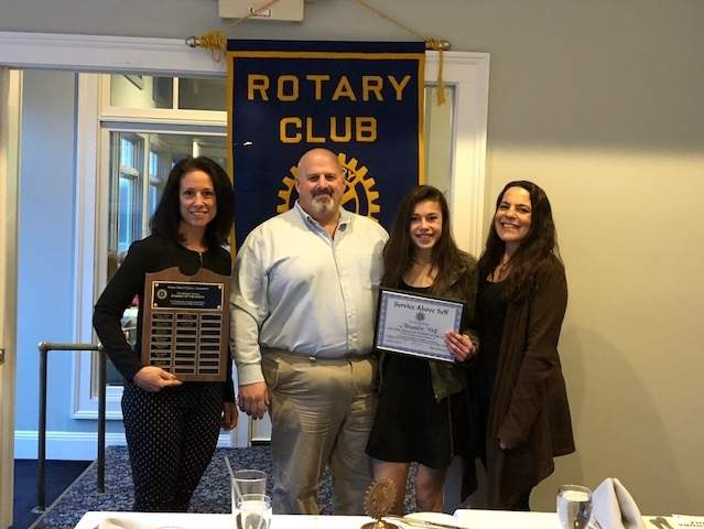 Clinton Rotary Club March Student of the Month Alexandra Wolf (second from right) displays her award with (from left) her nominating teacher Susan Peterson, father Mark Wolf, and mother Andrea Wolf. Photo courtesy of Marcia Bird