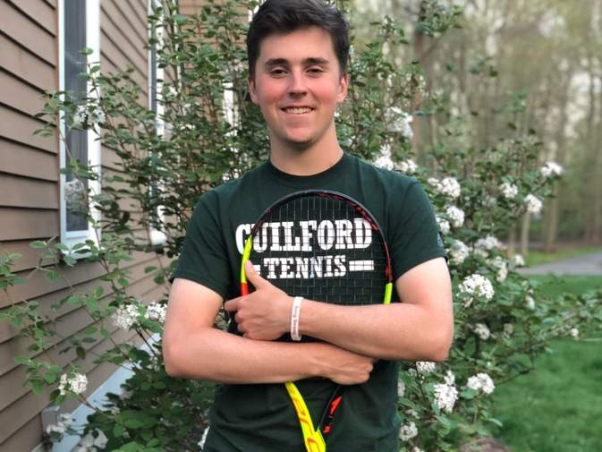 Michael Hooker has an overall record of 16-1 and is 9-0 while teaming up with fellow senior captain Sam Inchalik at the No. 1 doubles position for the Guilford boys' tennis team this spring. Photo courtesy of Michael Hooker