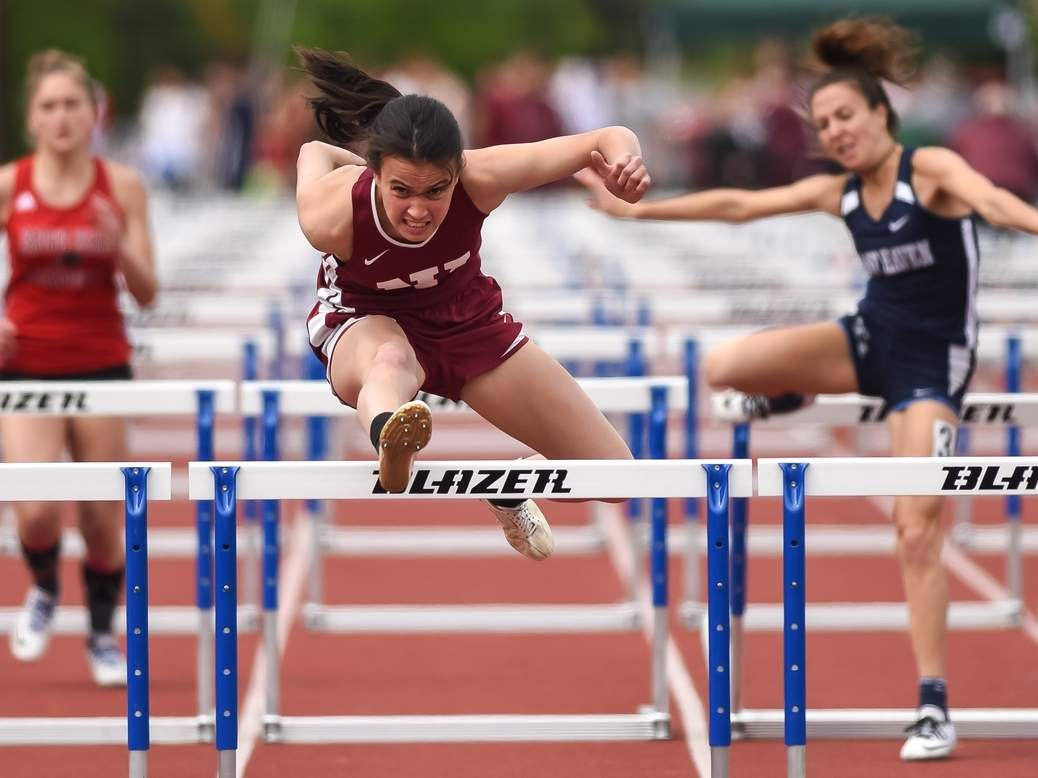 Junior Giselle Zumerchik took first place in the 300 hurdles and placed second in the 100 hurdles to help the North Haven girls' outdoor track team finish fourth as a squad at the SCC West Sectional Championship. Teammate Erica Marriott won two events for the Indians, while Kyle Maruca won both the shot put and the discus for the boys' squad at sectionals. Visit Zip06.com to see more photos from this meet. Photo by Kelley Fryer/The Courier