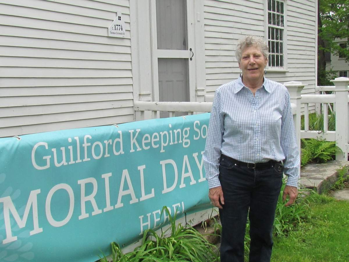 Guilford Keeping Society (GKS) member Barbara Johnson envisioned inviting the community to GKS's first Memorial Day Picnic 13 years ago. Now, she's excited to invite all to gather at a new GKS Memorial Day Picnic location that's right on the parade route—the Thomas Griswold House Museum, 171 Boston Street. The picnic takes place from 11 a.m. to 3 p.m. on Monday, May 28. Photo by Pam Johnson/The Courier