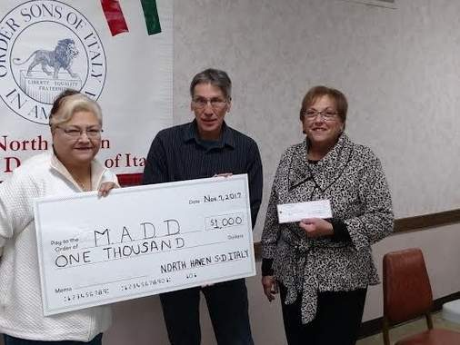 North Haven Sons & Daughters of Italy Lodge members Gale Iannone (trustee) and Mark DeFranco (treasurer) present a $1,00 check to MADD Representative Diane D'Agostino. Photo courtesy of Denise Mazzotta Krause
