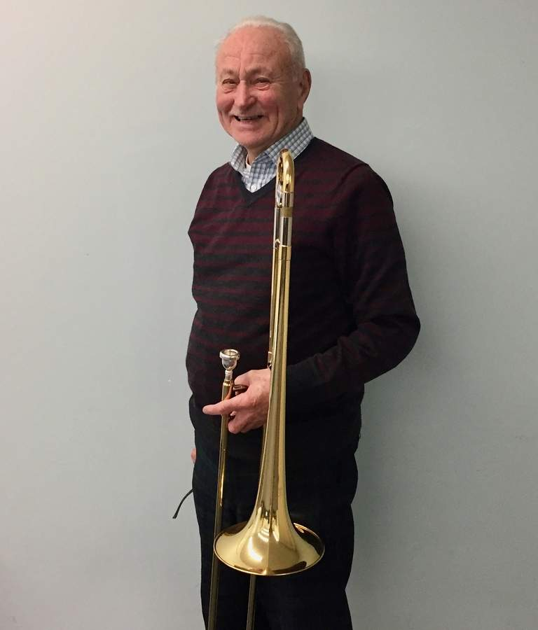 A lifelong singer, Bob Johnson took a half-century hiatus from playing the trombone, but he's back at it now as a member of the New Horizons Band.  Photo by Rita Christopher/The Courier