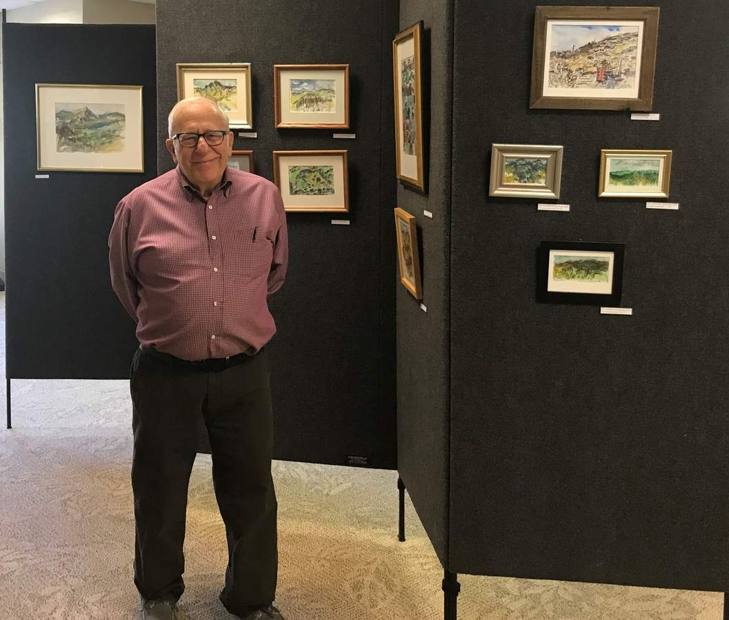 Notable artist Arthur Guagliumi of Northford shares some of his remarkable watercolors in a special exhibit on view throughout the month of February at the Edward Smith Library in Northford. Photo by Pam Johnson/The Sound