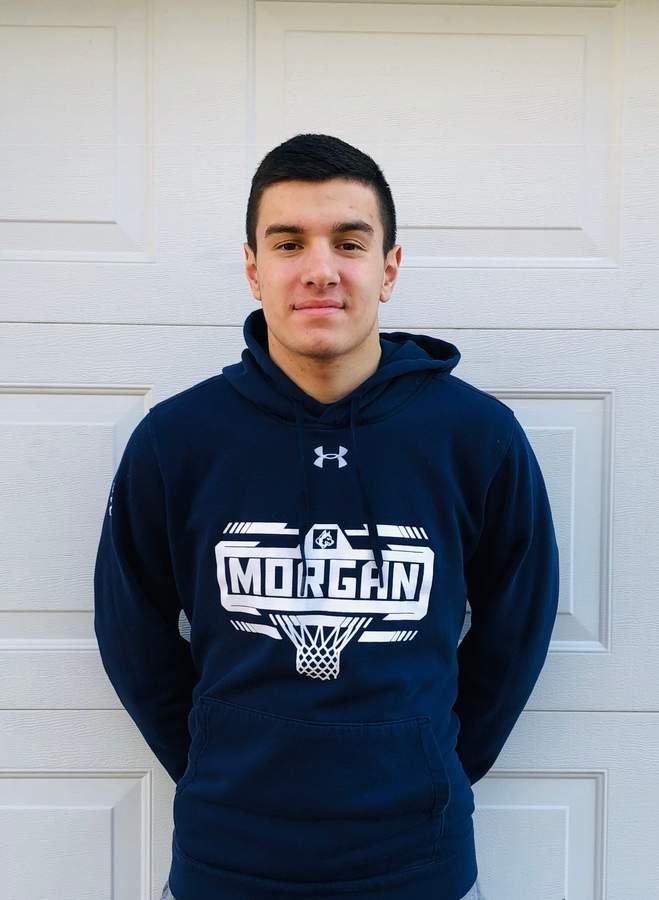 Senior captain forward Chris Nuzzo is averaging 11.1 points and 6.3 rebounds per game for the Morgan boys' basketball team this season. Chris and Huskies have a record of 13-5 after winning just four games all of last year. Photo courtesy of Chris Nuzzo