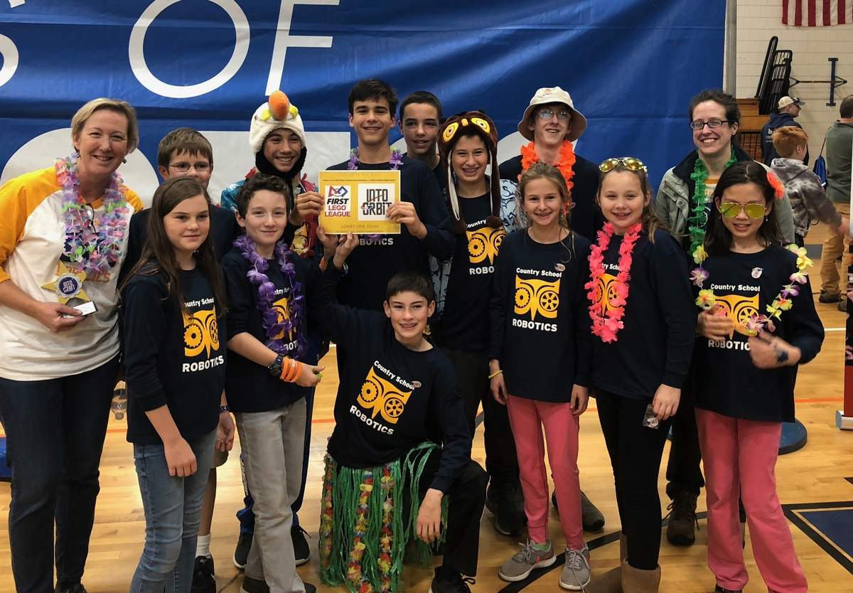In addition to her innovative classroom work, Guilford resident Stephanie Johnson (far left, holding award) is one of two coaches for The Country School's competitive robotics program. She's shown here at the 2018 fall regional First Lego League Robotics Tournament, where her team qualified once again for the state championship, and Johnson was named Best Mentor. Now, Johnson has been named a Women of Innovation finalist by the Connecticut Technology Council. Photo courtesy of Stephanie Johnson