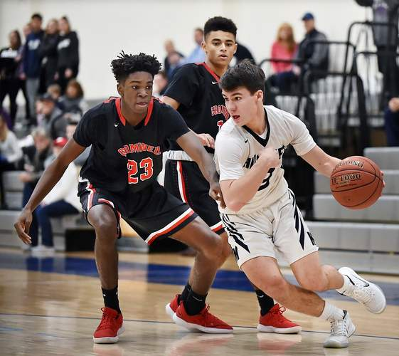 Senior captain guard Garrett Johnson and the Morgan boys' basketball team dropped a 61-41 decision to Old Lyme in the Division V State Tournament semifinals on March 11. Photo by Catherine Avalone/Harbor News