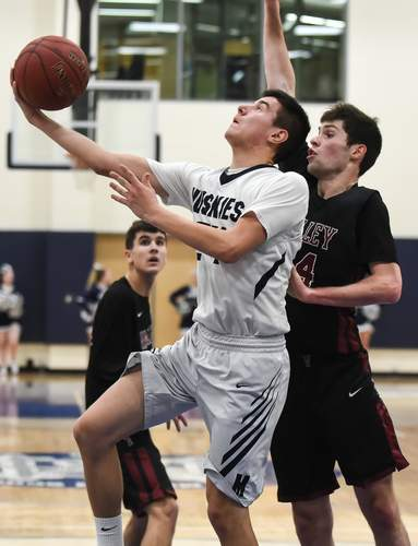 Senior captain guard Chris Nuzzo and the Huskies completed their season with a record of 17-8 after losing to Old Lyme in the Division V semis last week. Photo by Kelley Fryer/Harbor News