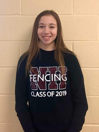 Senior captain Kathleen DeMaio made a big impact in the North Haven fencing program by helping the younger athletes on the sabre team progress throughout the season. Photo courtesy of Kathleen DeMaio