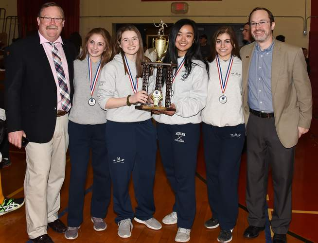 The Morgan co-ed fencing program had a strong year that featured some quality postseason performances. At the Team State Championships, the Huskies' girls' saber team came in second place. Pictured are Head Coach James Barnett, Angela Recine, Olivia Morrissey, Bea Atengco, Isabella Recine, and assistant Jim Harris. Photo by Kelley Fryer/Harbor News