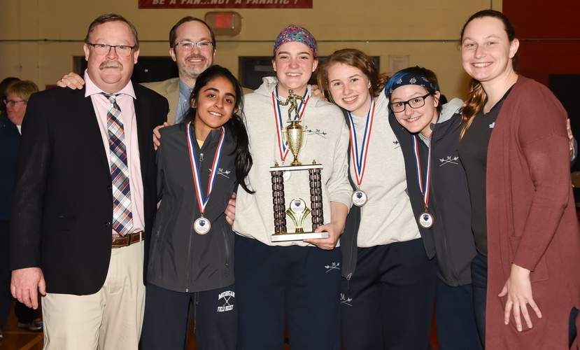 The Huskies' girls' épée squad claimed third place at the Team State Championships this season. Pictured are Head Coach James Barnett, assistant coach Jim Harris, Aadilah Bajwa, Jennifer Accetta, Lilly Morrissey, Lily Kozak, and former coach Colleen Mason. Photo by Kelley Fryer/Harbor News