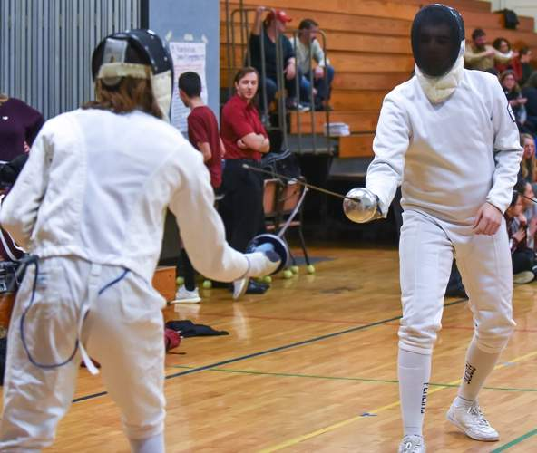 Senior captain Scott Accetta fenced épée while leading Morgan alongside fellow captains Rebecca Arribas Cockley and Olivia Morrissey this year. Photo by Kelley Fryer/Harbor News