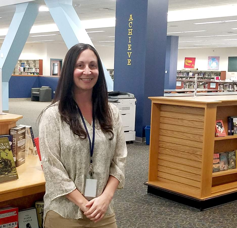 At home in the East Haven High School library, Juliet Goraieb is running dynamic programs that move students beyond the reference desk into real-life experiences.  Photo by Nathan Hughart/The Courier
