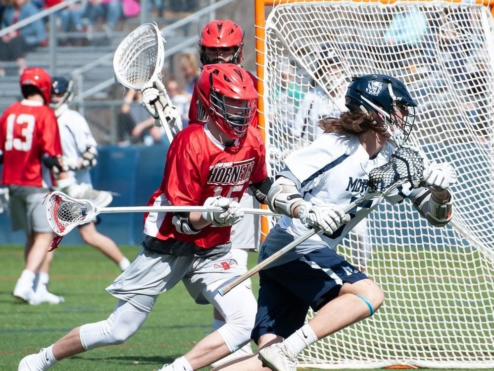 Senior captain Zak Johnson and the Morgan boys' lacrosse team earned two wins last week to even their record at 4-4 on the season. Johnson scored a goal had and two assists in Morgan's 14-5 victory against Old Saybrook on April 16. File photo by Kelley Fryer/Harbor News