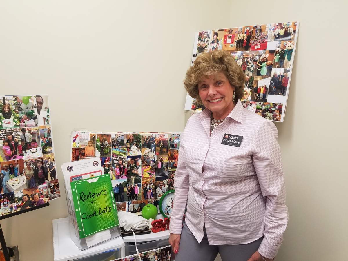 In her office at ShopRite's East Haven location, Anna Marie Luzzi keeps collages of photos from the many events she's helped to plan during her last four years as the organization's event coordinator. Photo by Nathan Hughart/The Courier