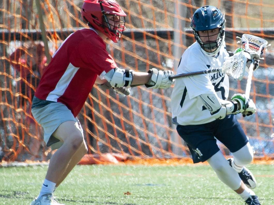 Sophomore Tim Lichack and the Morgan boys' lacrosse team qualified for the Class S State Tournament by picking up a pair of victories last week. Lichack scored five goals during the Huskies' clinching 15-2 victory over Cromwell on May 7. File photo by Kelley Fryer/Harbor News
