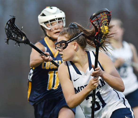 Junior Maddie Stopkoski reached a major milestone by scoring her 100th goal with the Morgan girls' lacrosse squad in a game against Old Saybrook on May 9. File photo by Catherine Avalone/Harbor News