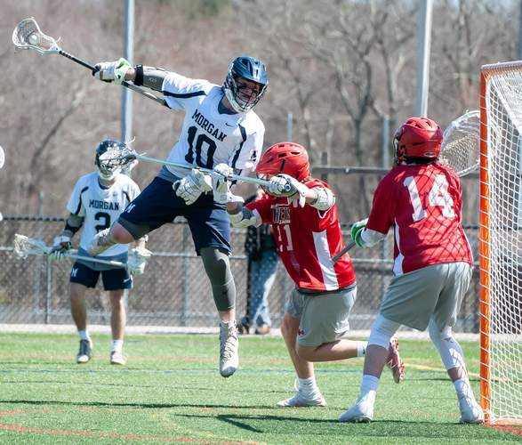 Matthew Lee and the Morgan boys' lacrosse team advanced to the Shoreline Conference final by earning a 10-9 win against Haddam-Killingworth in the semifinal round. File photo by Kelley Fryer/Harbor News