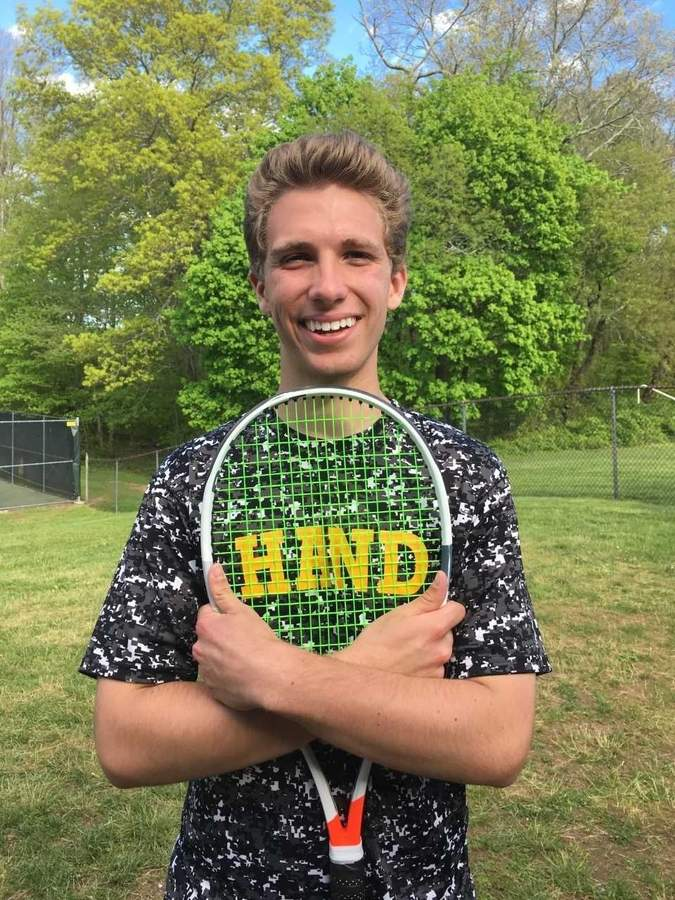 Senior captain Nick Chieppo is leading the Hand boys' tennis team while playing No. 2 doubles with freshman Will deChabert this spring. The duo has a record of 19-0 for the Tigers, who also went 19-0 during regular-season action. Photo courtesy of Susan Chieppo