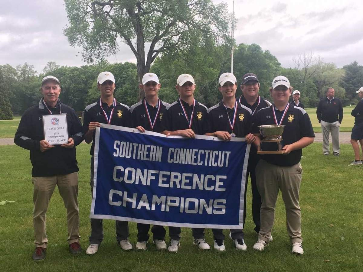 For the first time since 2014, the Hand boys' golf team stands with the SCC title. The Tigers shot a team score of 311 to take first place at the SCC Championship at Race Brook Country Club. Photo courtesy of Al Carbone
