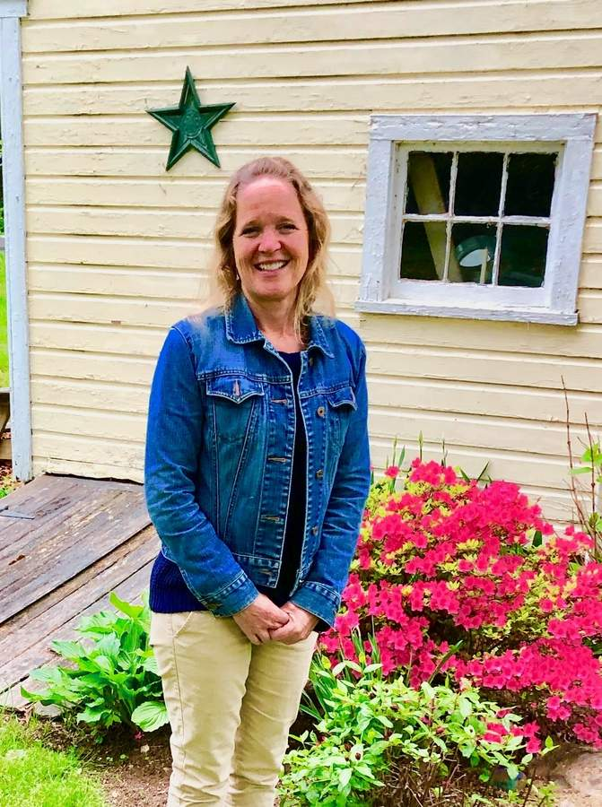 A fifth-generation local, Charlene Doane is helping others learn about their neighbors (and raise funds for the Ivoryton Library) with the Through the Garden Gate tour of historic homes and gardens in Ivoryton and Centerbrook on Saturday, June 15.  Photo by Rita Christopher/The Courier