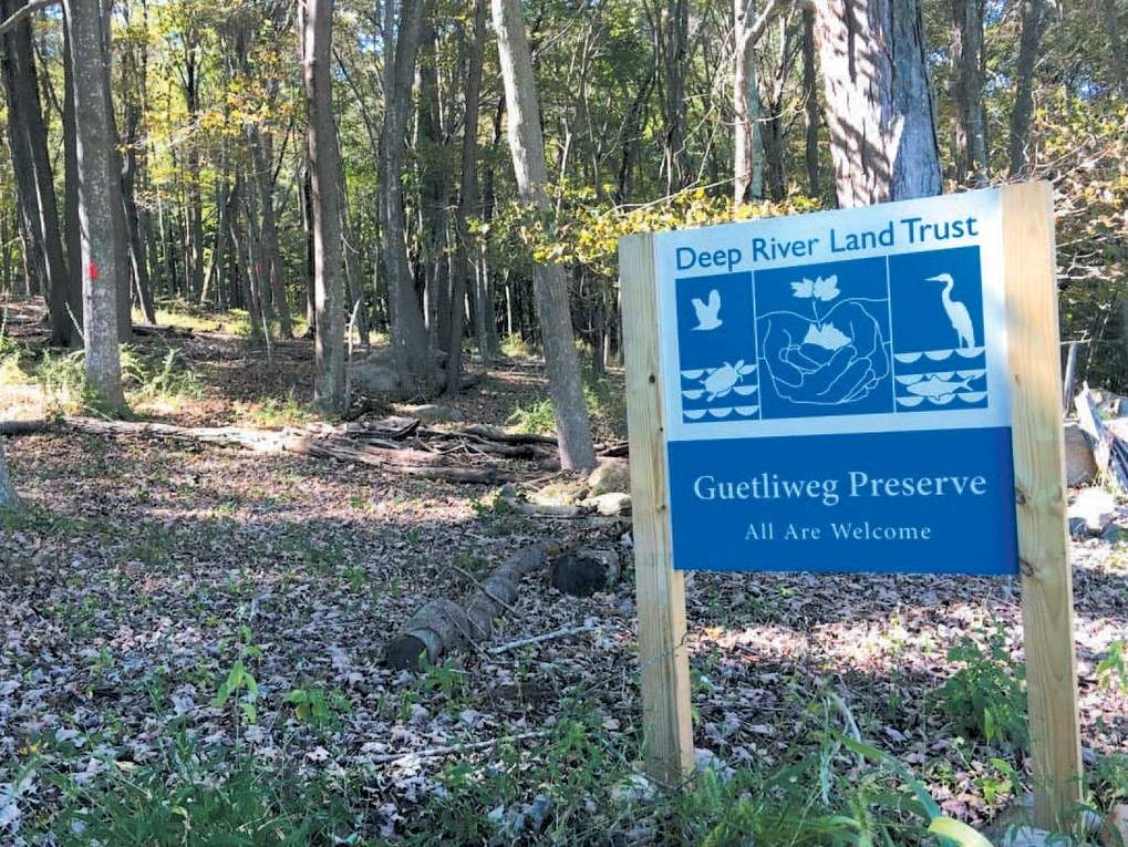 Look for blue and white road signs like these marking Land Trust properties.