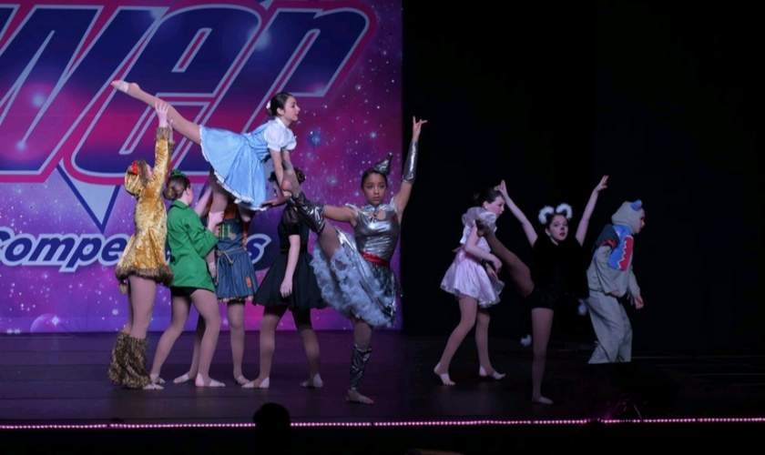 Westbrook Dance Academy's Junior team will go to the World Dance Championship to perform their routine of Goodbye Yellow Brick Road next month. Pictured are (standing) Isabella Johnson (Clinton), Calla Gilson (Old Saybrook), Sylvia Sonenstein (Madison), Gabrielle Walker (Westbrook), Madison Grady (Clinton), Olivia Hartmann (Clinton), Tess Santarsiero (Old Saybrook), Jaidyn Cote (Old Saybrook), and (being lifted) Gabriella Navarra (Clinton). Photo courtesy of Westbrook Dance Academy