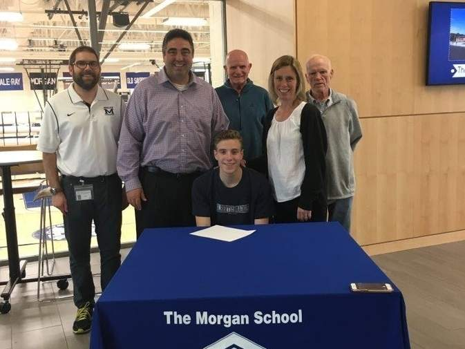 Morgan boys' soccer alum Andrew Passante is going to play soccer at Albertus Magnus College this fall. Pictured are Tyler Webb, the assistant principal of The Morgan School, along with Passante's father Chris Passante, his grandfather William Mangler, his mother Becky Passante, and Kevin Rayel, the athletic advisor at Morgan. Photo courtesy of Chris Passante