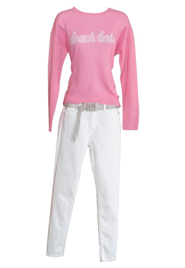 Cashmere sweater in pink, $333Denim pant in white, $134  Rhinestone belt, $158    Photographed by Kelley Fryer/elan Magazine