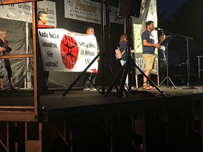 Immigration activist John Jairo of New Haven-based Unidad Latina en Acción  (ULA) addresses the crowd at the Branford Lights for Liberty rally on July 12.  Pam Johnson/The Sound