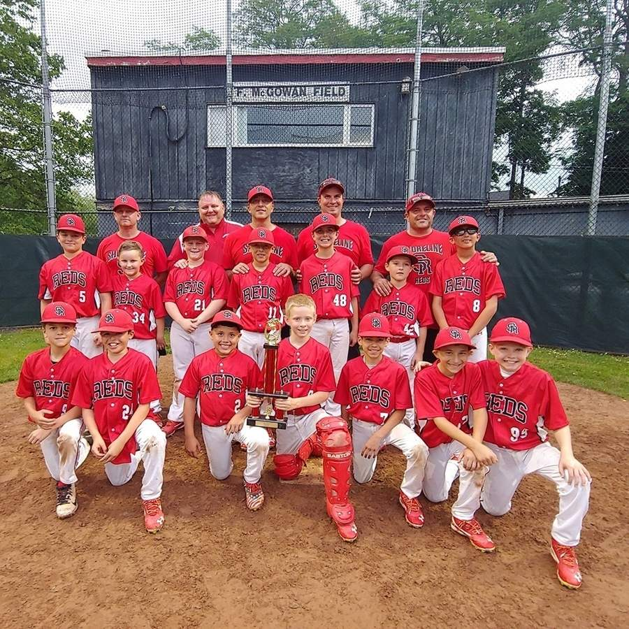 The Shoreline Reds went 20-2 and claimed the title in the East Shore Travel League this spring. Pictured are (front) Eli Showerda, Carolino Montiero, Jay Chacon, Christopher McKittrick, Gio Ramos, Shaun Swanson, and Dylan Weaver; (middle) Jake Giacco, Will Miller, Connor Scott, Gavin DeFelice, Finnegan Knowlton, Jacob Izaguirre, and Gennaro Marino; (back) assistant coaches Bill Miller and Tim Scott, Head Coach Todd DeFelice, and assistant coaches John Knowlton and Frank Izaguirre. Photo courtesy of Liesl Knowlton