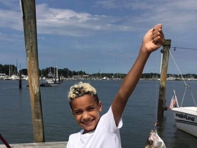 Proud Gunnar Smith, 10, visiting from New York, landed his first porgy (scup) while fishing Branford waters. Photo courtesy of Captain Morgan