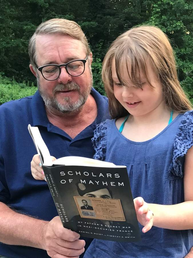Madison resident Timothy K. Smith shares his recently released book about D-Day with his daughter Lucy. Photo courtesy of Tim Smith