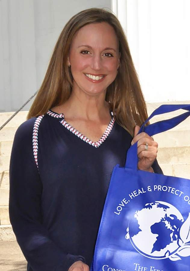 Lisa Brown, a graphic designer who moved to Madison 11 years ago, has used her skills to help different organizations in town, including the bags given away by the First Congregational Church at the farmers market. Photo courtesy of Lisa Brown