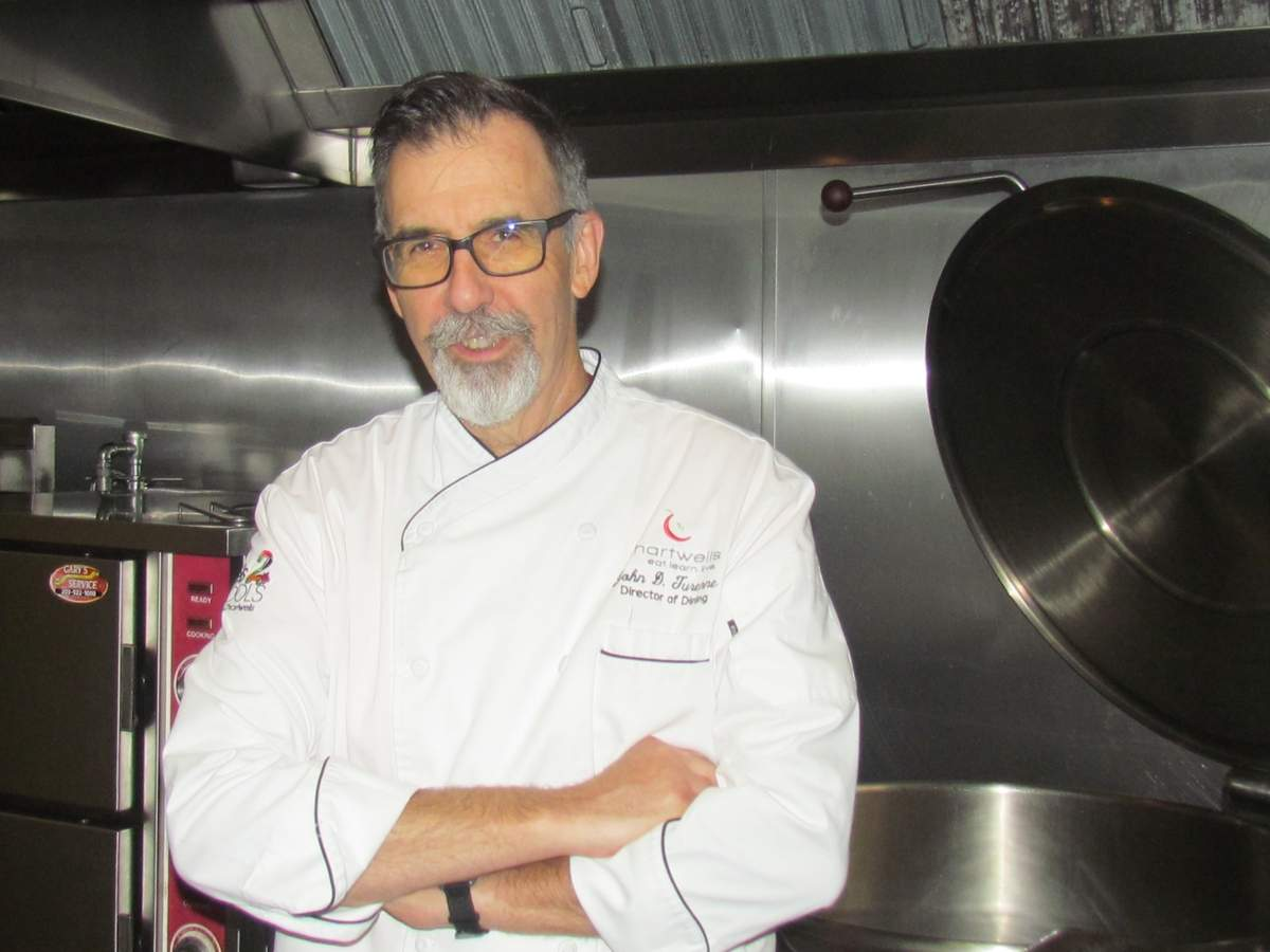 Coming up on his first anniversary as Branford Public School's director of dining/executive chef, John Turenne of Chartwells says the program's success is due his talented and dedicated dining team staff and the support of community stakeholders.   Photo by Pam Johnson/The Sound
