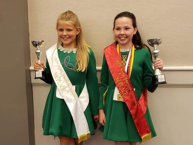 Briella Dean of East Haddam and Olivia Hartmann from Clinton earned National Champion status with their performances at the Rince Tuatha Nua National Championships in Mystic. Dean and Hartmann were both representing the Mulkerin School of Irish Dance class at Westbrook Dance Academy when they competed at the event. Photo courtesy of Westbrook Dance Academy