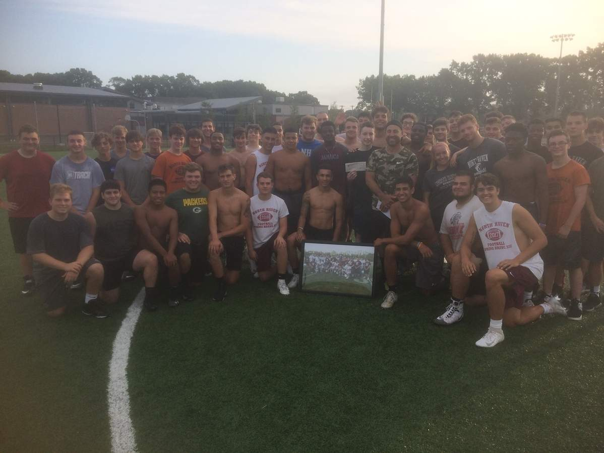 The North Haven football squad helped raise $11,600 for town resident Zak Radziunas through the team's 15th annual Spring Brawl fundraiser. Photo courtesy of Anthony Sagnella