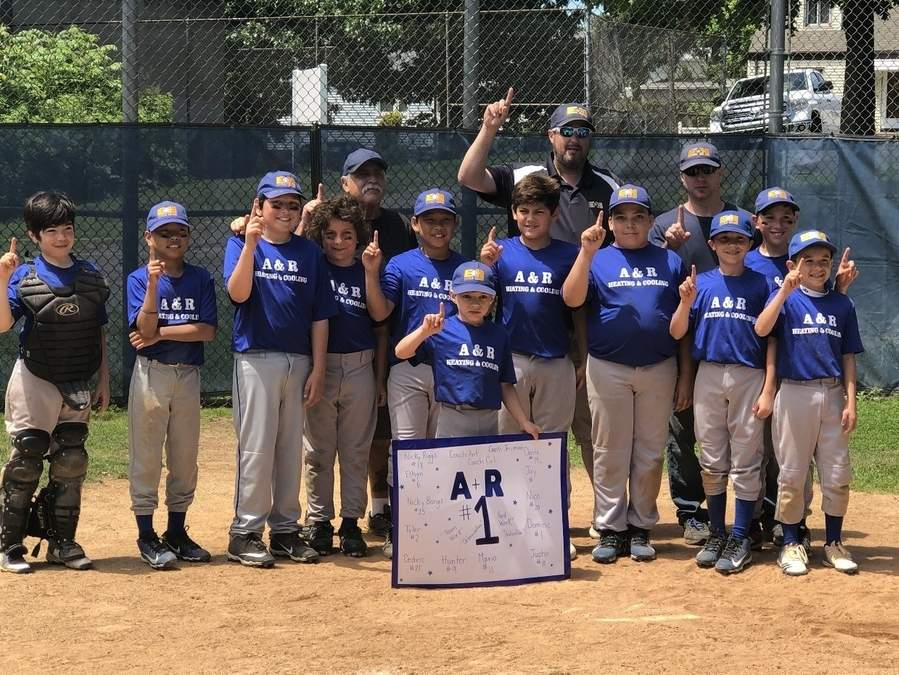 A & R Heating and Cooling won the title in the East Haven Little League Junior Majors Division for the fourth year in a row. Pictured are (front) Nick Vocatura, Cedric Gabasan, Ethan Iasparra, Mario Sargent, Tyler Ho, Hunter Stewart, Dante Garea, Justin Malicki, Nicholas Rignoli, Nico Velez, and Dominic Verderame; along with (back) assistant coach Cal Conte, Head Coach Anthony Rignoli and assistant coach Jeremiah Stewart. Photo courtesy of Raeann Rignoli